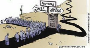 """Cartoon of an unending mass of people headed towards a fork in the road. At the for there is a book case and a sigh which read """"Answers."""" Below that, there are two arrows. Arrow pointing left says, Simple but wrong. Arrow to the right (placed above a bookcase) reads """"Complex but right."""" The road splits. The """"complex but right"""" road is narrow and winds its way up a mountain. Very few people are on this road. The """"Simple but wrong"""" road left leads hundred of people off a cliff."""